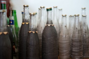 Bottles prepped with the first layer of glue and thread