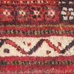 Running water motif in the border of a Qashqai rug